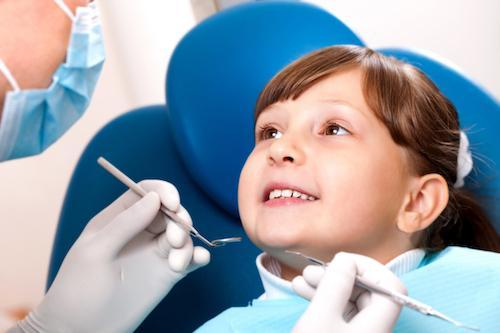 child smiling at Bastrop pediatric dentist